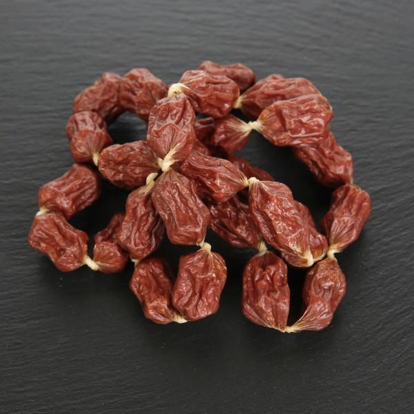 Salamipralinen Ziege mit Hagebutte und Cranberry